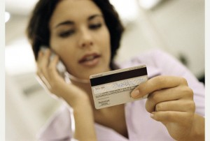 A Generic photo of a woman using her creditcard over the phone. See PA Feature CONSUMER Scam. PA Photo/ Handout.